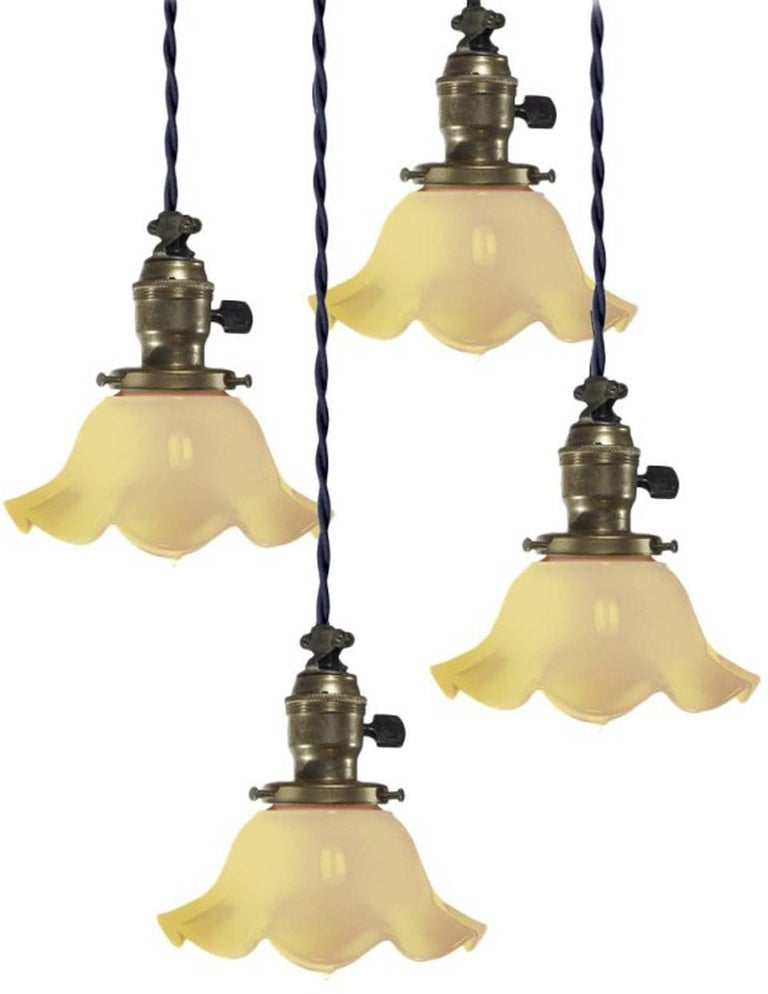 American Collection of Ruffled Vaseline Glass Pendants For Sale