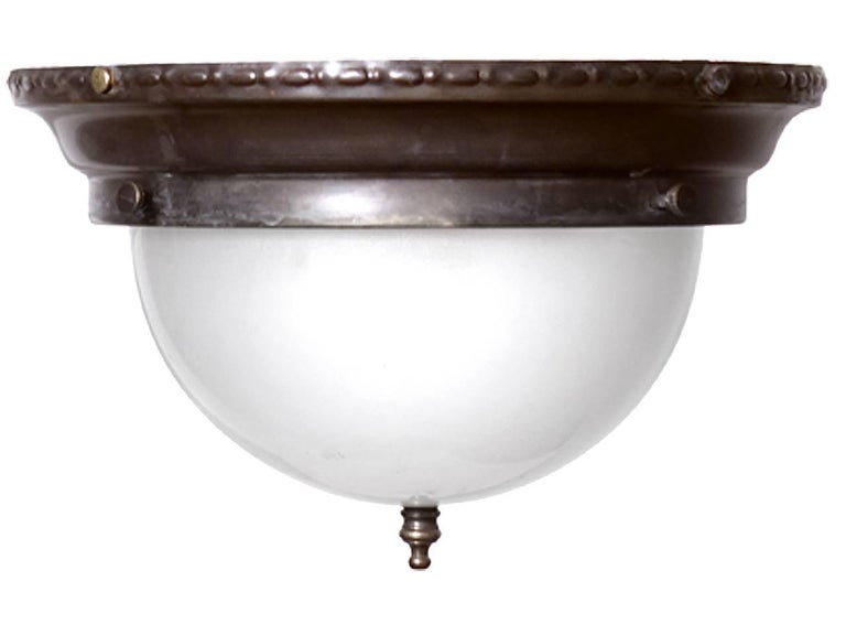We have a nice collection of these 10.5 inch domed flush mount lamps. Each take two candelabra bulbs and have simple period decorative details.