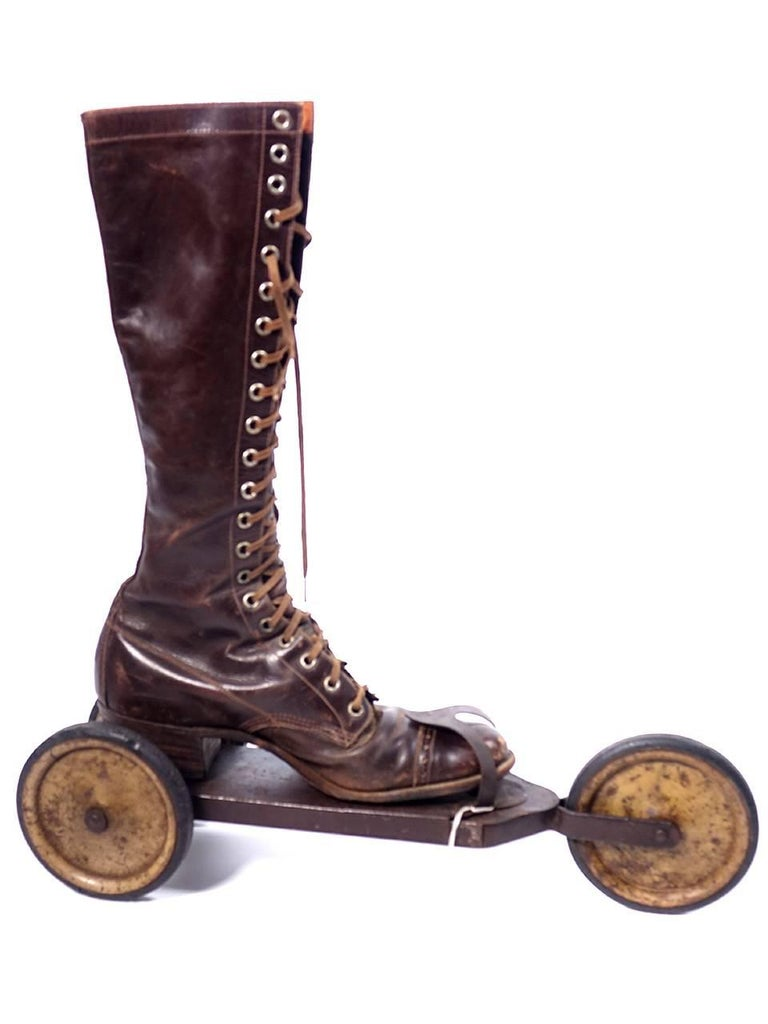 This is a rather unusual and rare pair of three-wheeled roller skates from the early 20th century. They are made of metal, with hard-rubber treads on the wheels; each skate is 16 inches long. There is no makers mark. Some research brought up skates