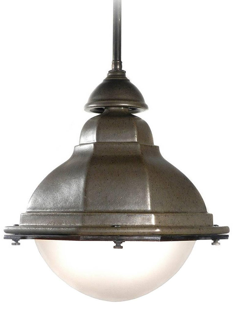 This is a beautifully glazed heavy terracotta lamps was inspired by turn-of-the-century cast iron French street lights. The finish is kiln fired producing a subtle patina in a dark matte green gray. It has the feel and finish of Teco pottery. It has