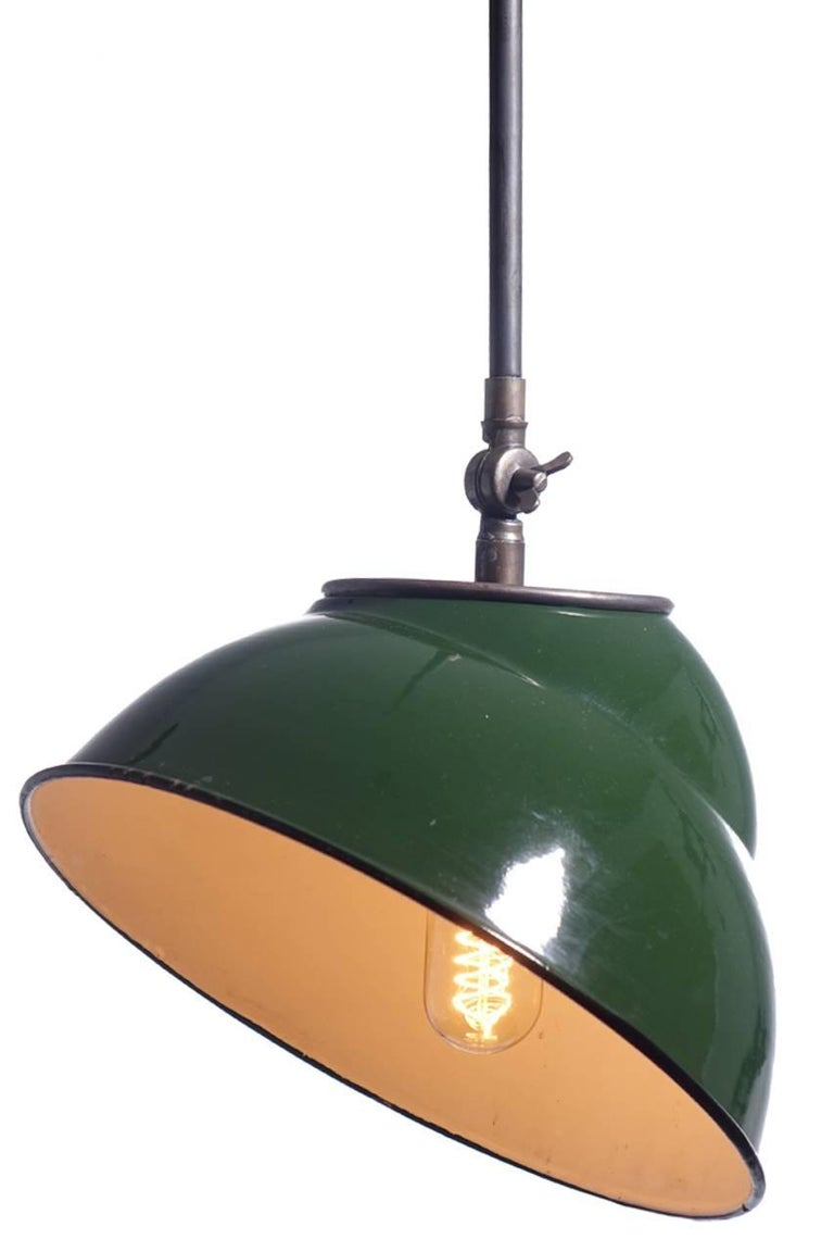 What is nice about these offset industrial shades is the ability to set them on any angle. The green over white finish is very nice with a little bit of patina showing. The shade has a double stepped double dome design.