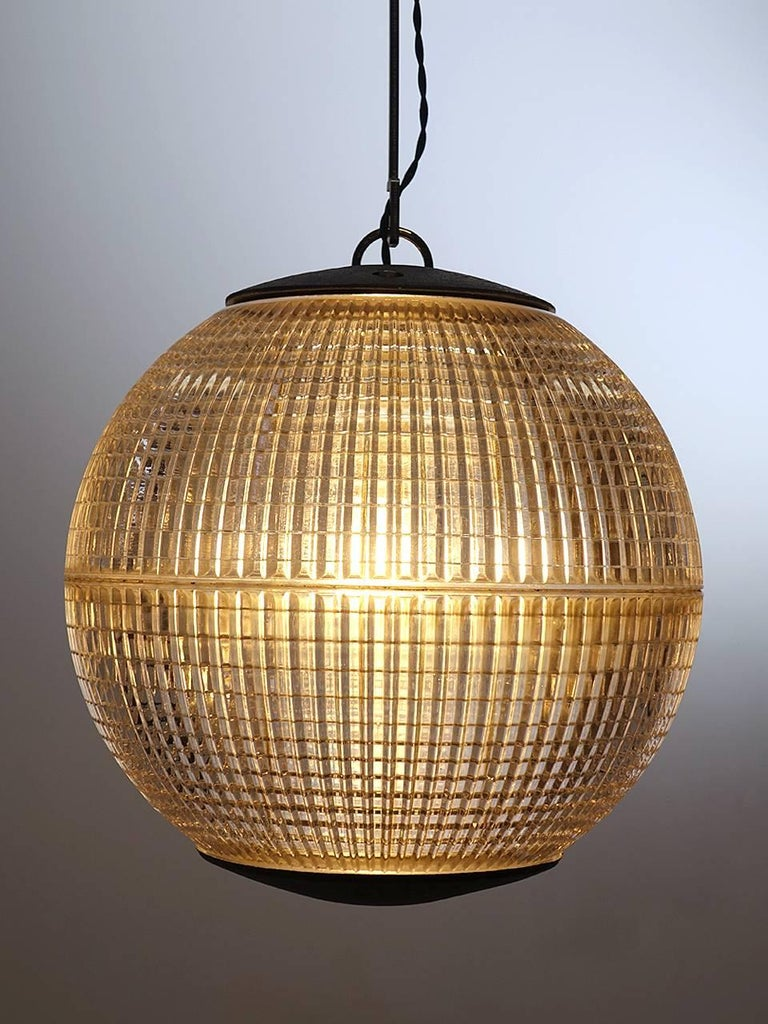 This iconic midcentury prismatic sphere once lighted the thoroughfares of Paris. If you have spent time there you know these lamps well. Since being saved from it's lamp post, this Industrial globe has been rewired for modern, indoor use and the end