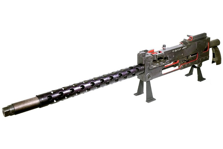 Oversized WWII era cut-away training model of the model 1919 machine gun with an overall length approximately 76 inches. The display is made of aluminium and sheet metal and shows all working parts in detail. The finish has not been over polished