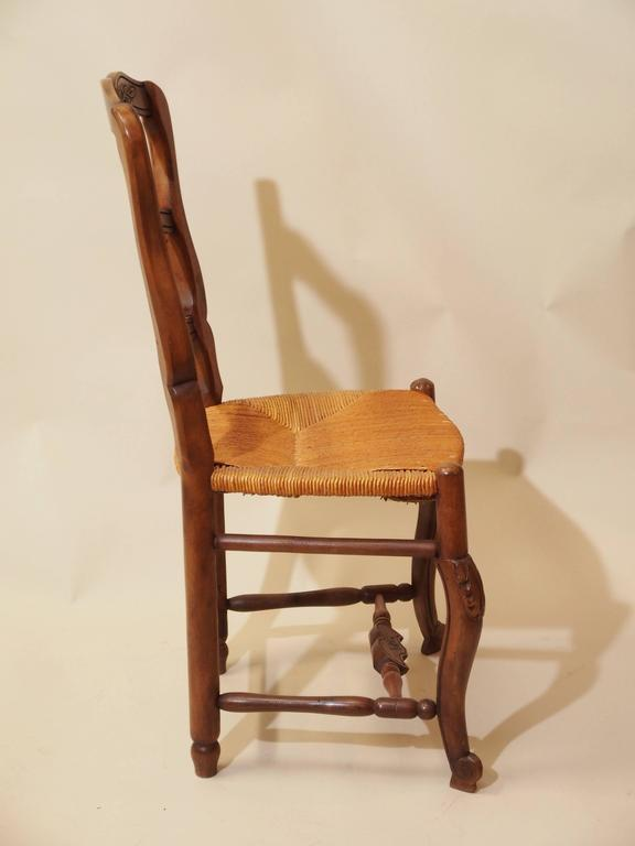 20th Century Set Of Eight Antique French Walnut Provincial Dining Chairs For