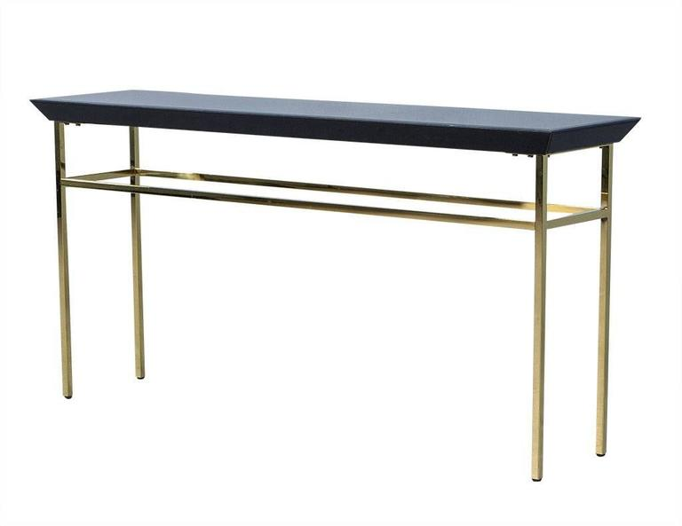 Black glass and gold metal console table at stdibs