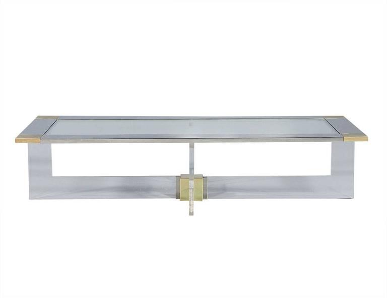 Designed by Randall Tysinger, this cocktail table is a visual pleasure for the modern furniture lover. The bold straight edge geometric construction of the t-base supporting a rectangular top integrates well with the use of pure materials, acrylic