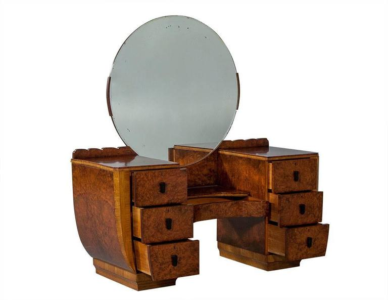 This Art Deco Style Vanity Is Crafted Out Of Burled Wood And Finished In A Um