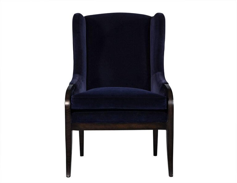 These transitional style chairs are smartly designed and crafted. The frames are made of espresso-stained show wood and upholstered in a deep navy blue velvet. These wing back chairs truly embodies comfort and flair and the perfect contrast for any