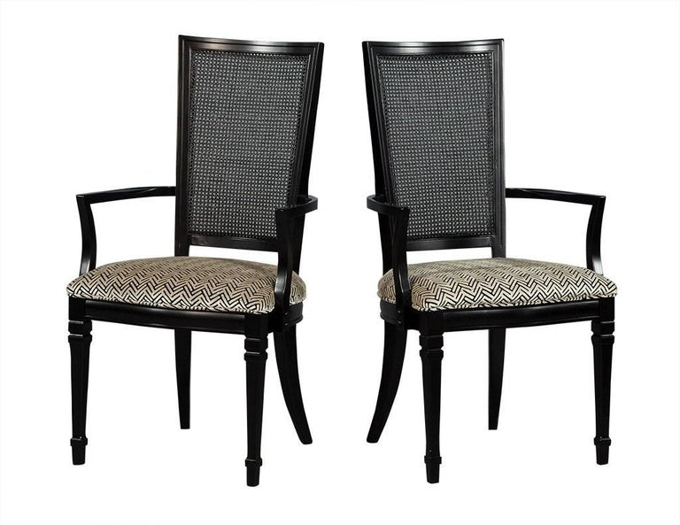 These Louis XVI style dining chairs are chic and sophisticated. Crafted out of solid black walnut, this set of six are excellently restored. The set includes two arm chairs and four regular, and truly adds endless character to your dining room!