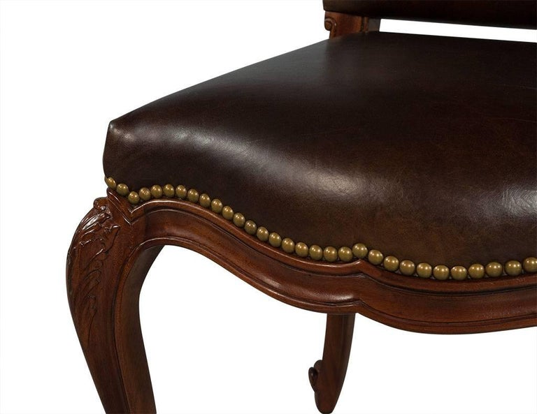 Set of eight carved leather studded louis xv style dining