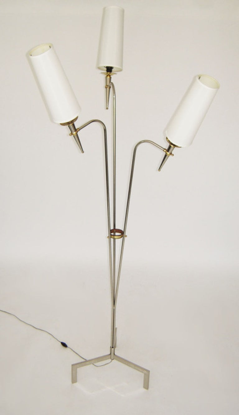 Three-arm floor lamp fabulous French design. Midcentury French floor lamp with three curving arms supporting conical stems on three feet. Mixed metal finishes and details. Original attached silk shades. After or in the style of Sarfatti, Arteluce,