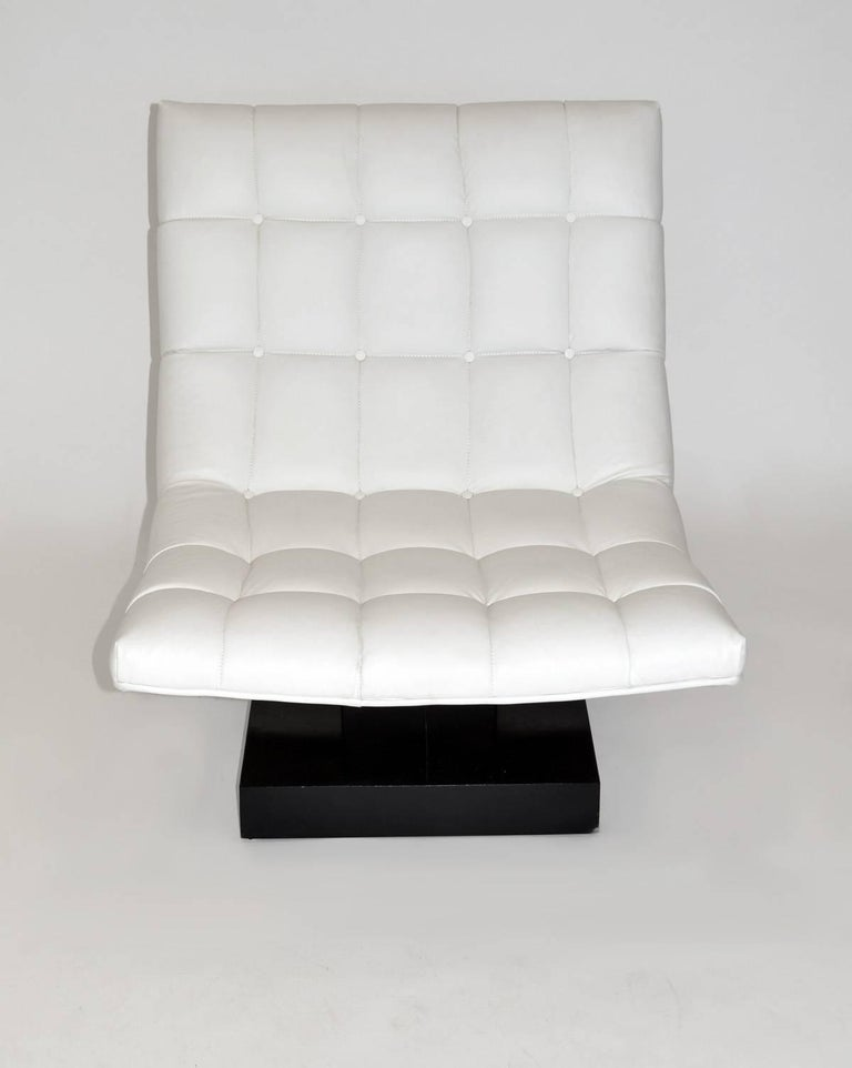 Pair of Milo Baughman leather 'Scoop' lounge chairs for Thayer Coggin minimalist white on black. Tufted true white leather upholstery over laminated, floating wood base. Labeled, 1980s.