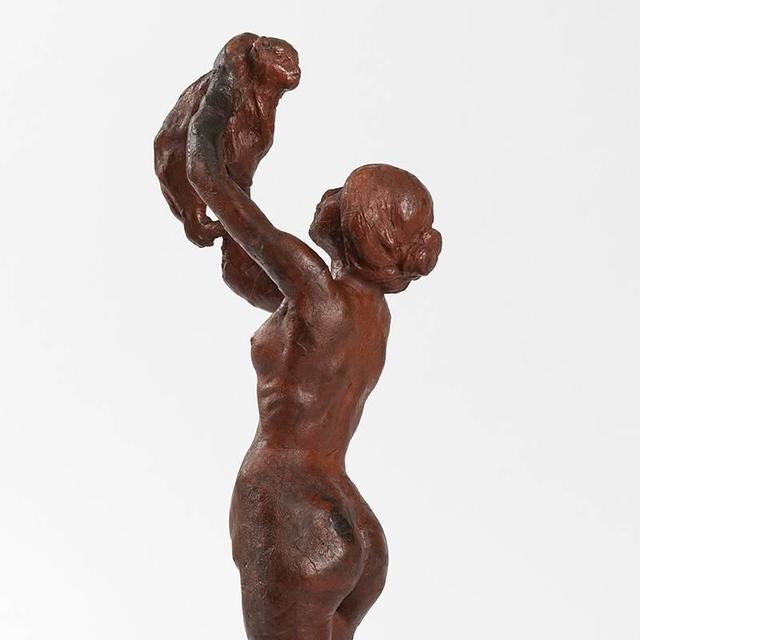 "A French wax sculpture, ""Woman and Cat,"" by Rupert Carabin, circa 1896.