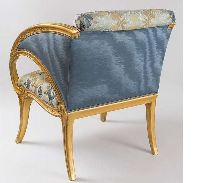 A pair of Spanish Art Nouveau armchairs with giltwood frames by Joan Busquets. Made for Antonio Gaudi's Palacio Güell, Barcelona, Joan Busquets crafted much of Gaudi's furniture. Circa 1903.  A member of a family that was long involved in the design