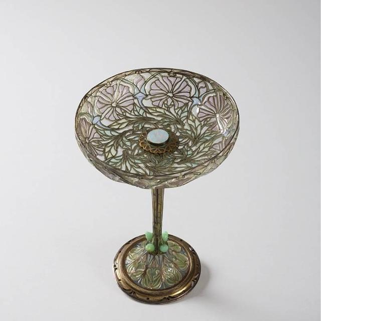 A French Art Nouveau silver and plique-a'-jour enamel coupe d'ornement by Euge'ne Feuilla^tre, circa 1900.  This exceptional compote features delicate and stylized floral patterns on the upper and lower portions. Green leaves encircle the base of
