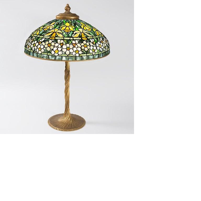 A Tiffany Studios New York gilt bronze and Favrile glass