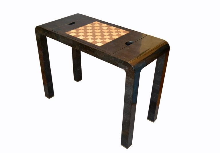 Mid-Century Modern reversable console into a chess or backgammon game table by Maitland Smith. A dark gray tessellated stone over wood covered table or console. The centre section can be rotated into a chess game or taken off to play