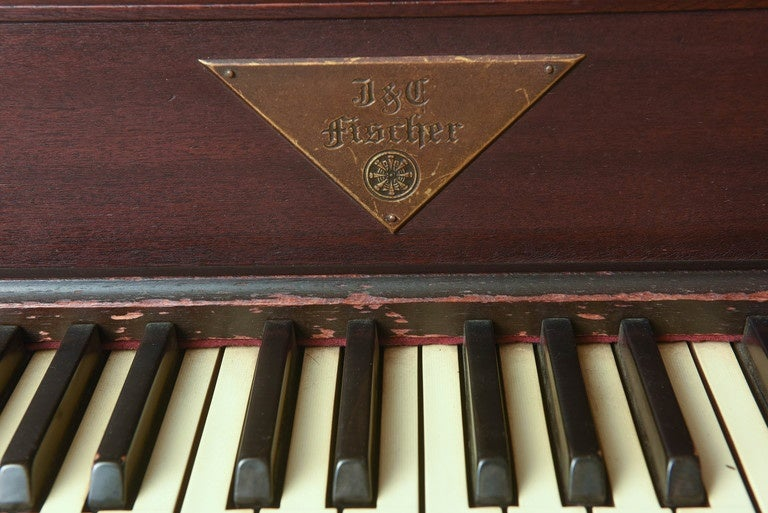 J & C Fischer Gothic style baby grand piano dated to 1926-1927. This piano carries serial number 154100. This very special piano does need to be re-finished. 