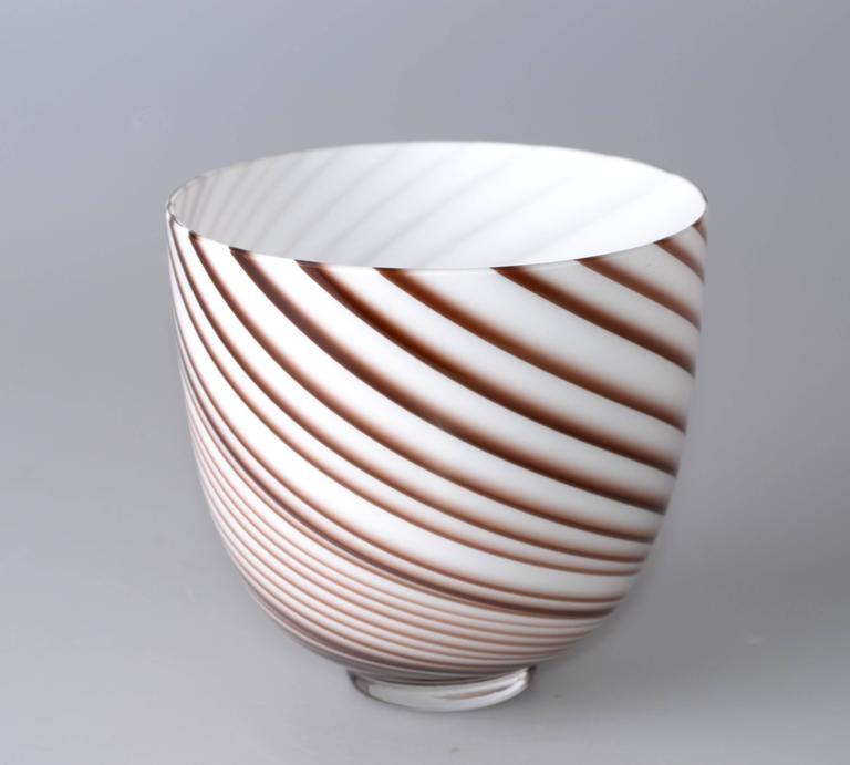 Original Tommaso Barbi Italian Murano bowl or vase in a candy swirl design motif with white opalescent and burgundy coloring. Open flared vase or accent as a centre bowl. Clear round base with polished pontil. Signed underneath.