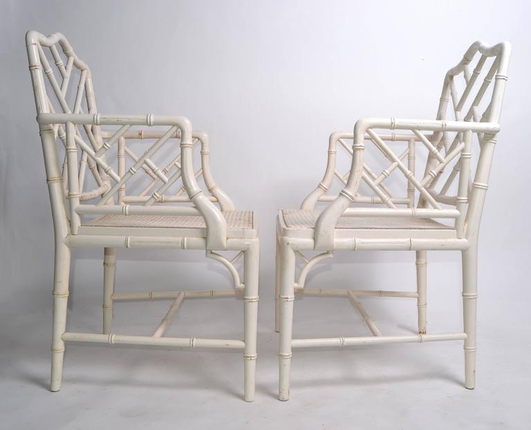 A pair of Hollywood Regency faux bamboo Chippendale armchairs. Professionally refinished. No makers mark.  Measures: Arm height 26.63 inches.