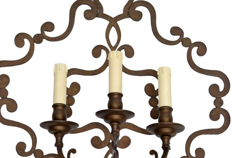 Wrought iron three-light applique, wall sconce from Italy. Wired for the U.S. prior shipping and uses each a max. 40 watts light bulb.