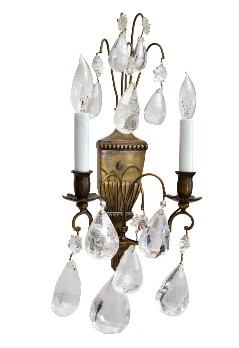 Bohemian rock crystal and bronze wall sconces, a pair. Each wired for the U.S. and uses 2 max. 40 watts light bulbs.