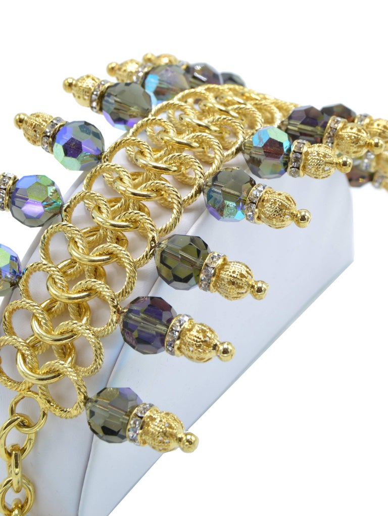 Justin Joy costume runway bracelet in gold leaf and blue stones, Italy.