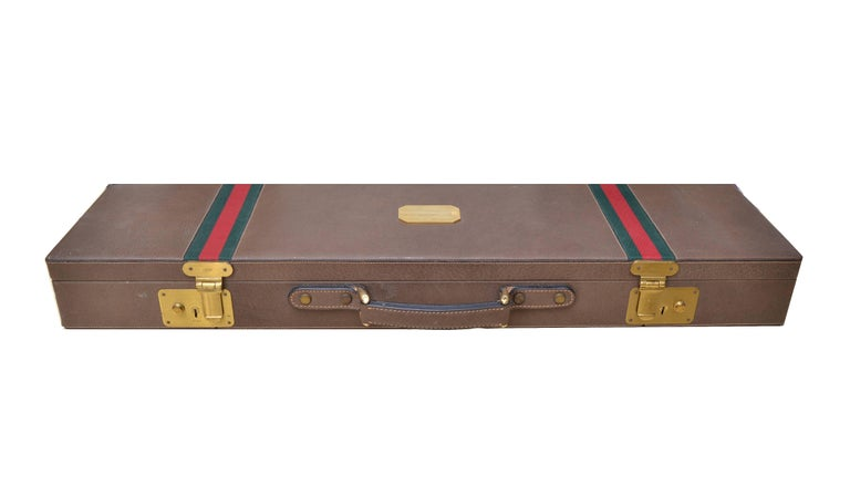 Original Gucci shotgun case in leather and brass.