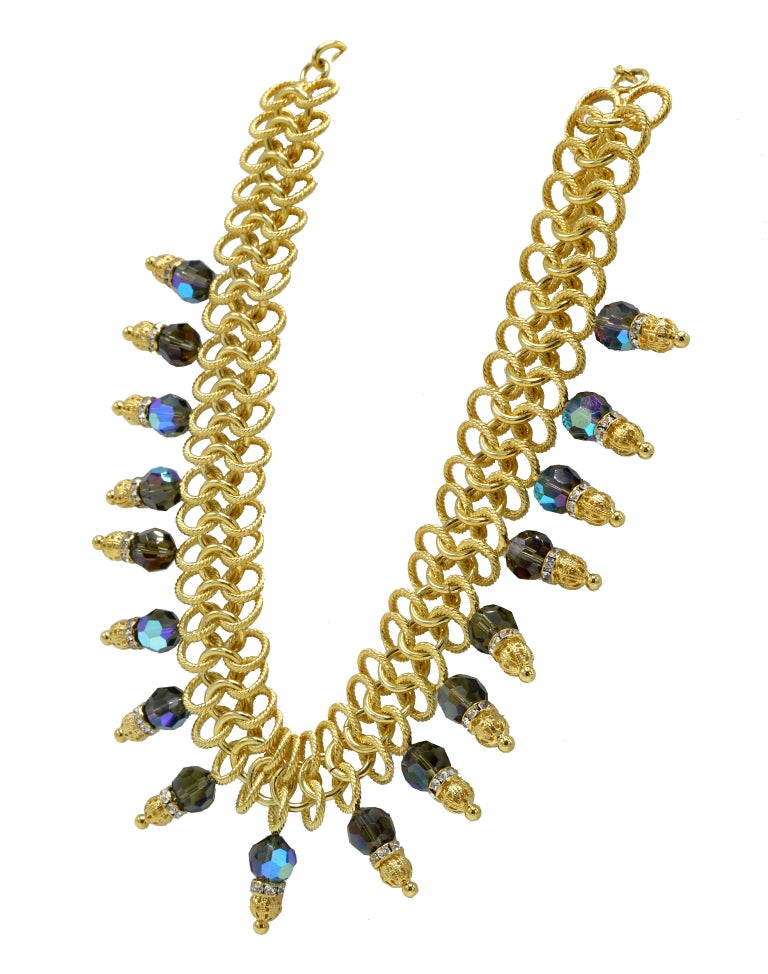 Italian runway necklace in gold and blue by Justin Joy. Contains Jaipur stones.