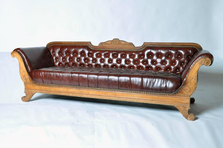 This Handsome British Raj Style Sofa Features Hand Carved Teakwood And Is From Gujarat