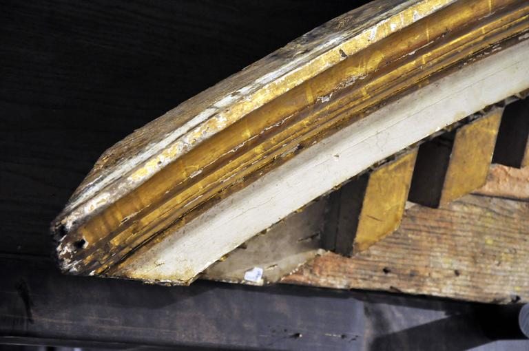 This grand piece of moulding once framed an archway. Classical elements are seen in the rectangular and floral-form beading on the inner moulding. The piece is Italian and made from pine wood. Probably from a church.