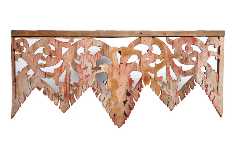 This Thai temple lintel decoration features vine and floral motifs. Thai temple entrances were made according to post and lintel design with a purely decorative panel below the structural lintel beam.