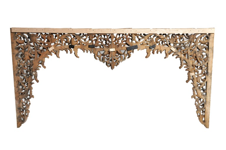 This hand carved Burmese arch was made from Teak wood. This impressive decoration features vine and floral motifs and were made according to post.