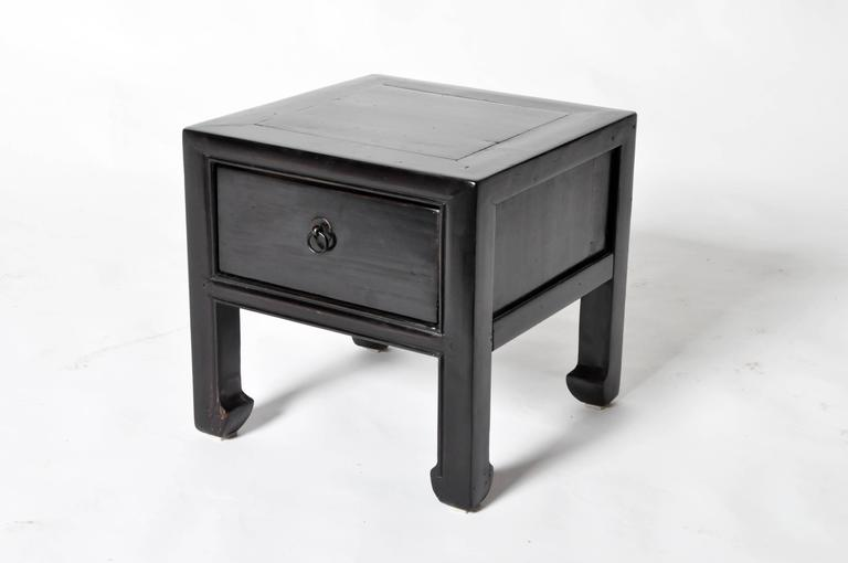 These Chinese stools are made from elmwood and has been fully restored. They each features one drawer and hoofed legs.
