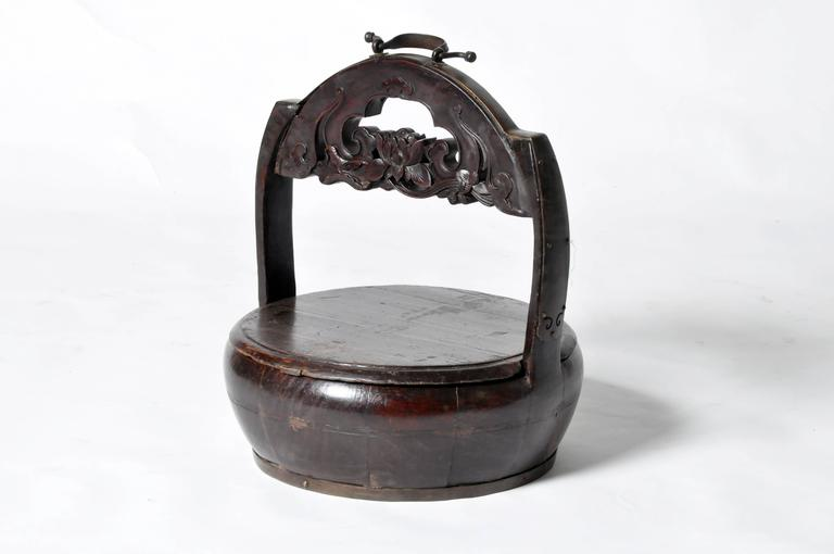 This Chinese food carrier is from Fujian, China and is made from softwood.