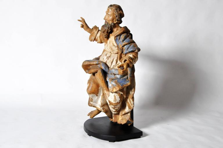 This sculpture of Saint Peter is from Italy and is made from poplar wood, circa 16th century. Saint Peter, according to the New Testament, was one of the 12 Apostles of Jesus Christ, leaders of the early Christian Church. He is also the
