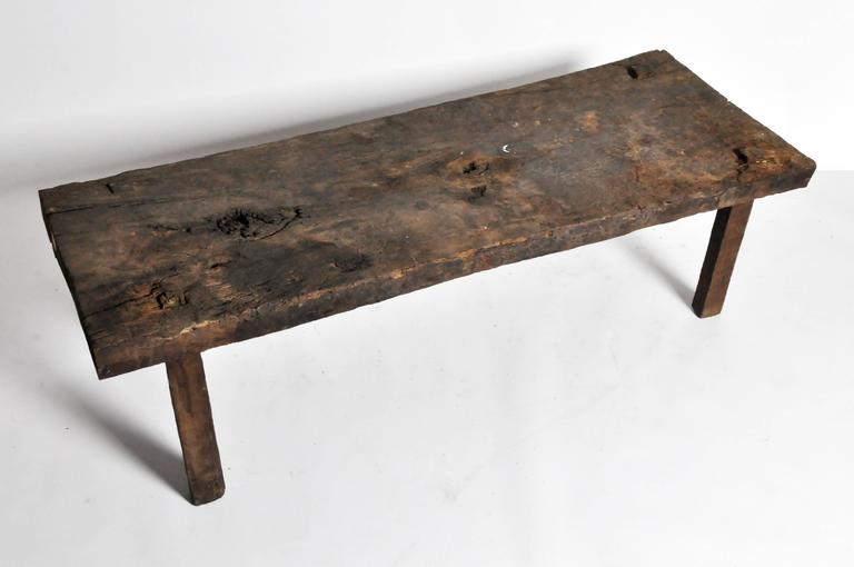 This rustic coffee table is from France and is made from rough oakwood, mid-1800s.
