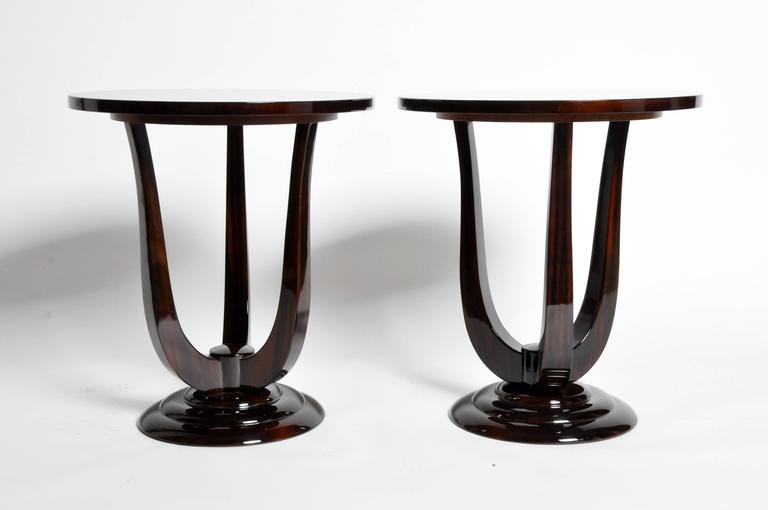 These elegant Mid-Century style side tables are from Hungary and made from Macassar veneer. They are great for side tables or end tables.