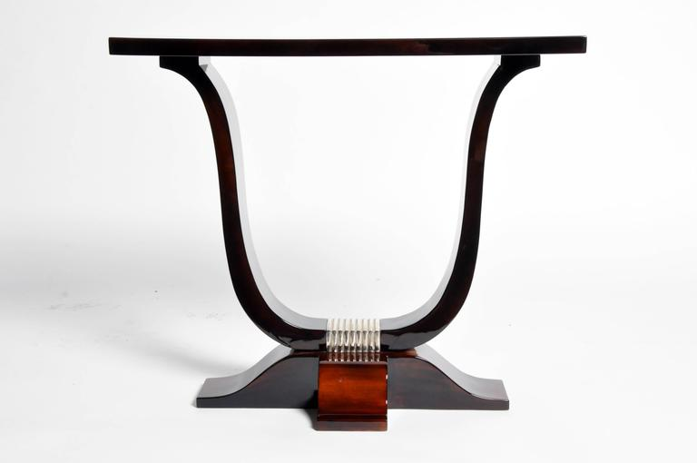 This newly made Art Deco style table is from Hungary and is made from walnut veneer.