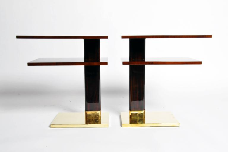 These elegant newly made side tables are from Hungary and are made from walnut veneer.