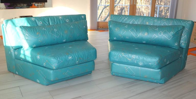 New old stock never been used pair of wedge shaped seating sections in the style of Milo Baughman and Vladimir Kagan. Made by Classic Gallery, Highpoint, circa 1995. Totally upholstered in teal chintz with hand-painted graphic designs in silver,