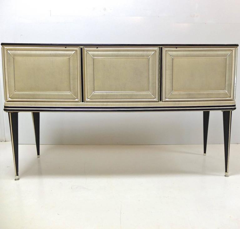 Early 1950s sideboard created by Umberto Mascagni of Bologna, Italy, imported to the UK by I. Barget and retailed through Harrod's, London, 1952-1955. Mascagni was known for his provocative use of new materials in furniture designs such as skai