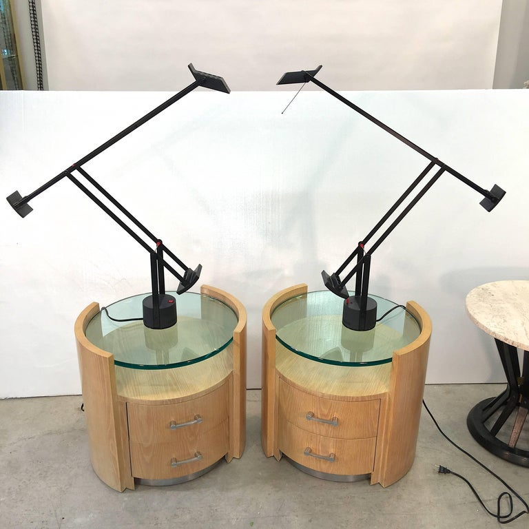 Designed by Richard Sapper for Artemide in 1972, the Tizio lamp is a true classic of modern design. Built with two counterweights to allow the user to direct the light where it's needed, the lamp adjusts with a pull or push and stays in place