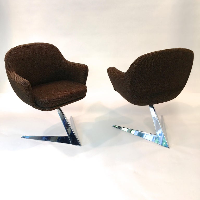 Incredibly handsome pair of chairs for dining, desk or occasional seating with dramatic Star Trek chromed steel base and woven wool upholstery.   According to our research these chairs were designed as a special private commission from the then