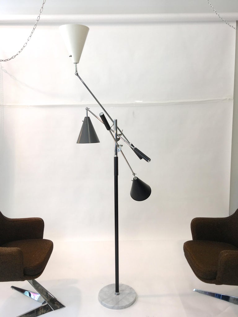 Angelo Lelii's 1951 Triennale Award winning three-arm floor lamp produced in Italy for export by Denis Casey for Casey Fantin, Firenze and imported to the USA by Koch & Lowy. Marked 'Made in Italy