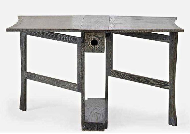 This is the chicest most stylish little gate-leg table that would be perfect for a pieds-a-terre to use for dining or writing or serving.   Crafted by James Mont, this signed