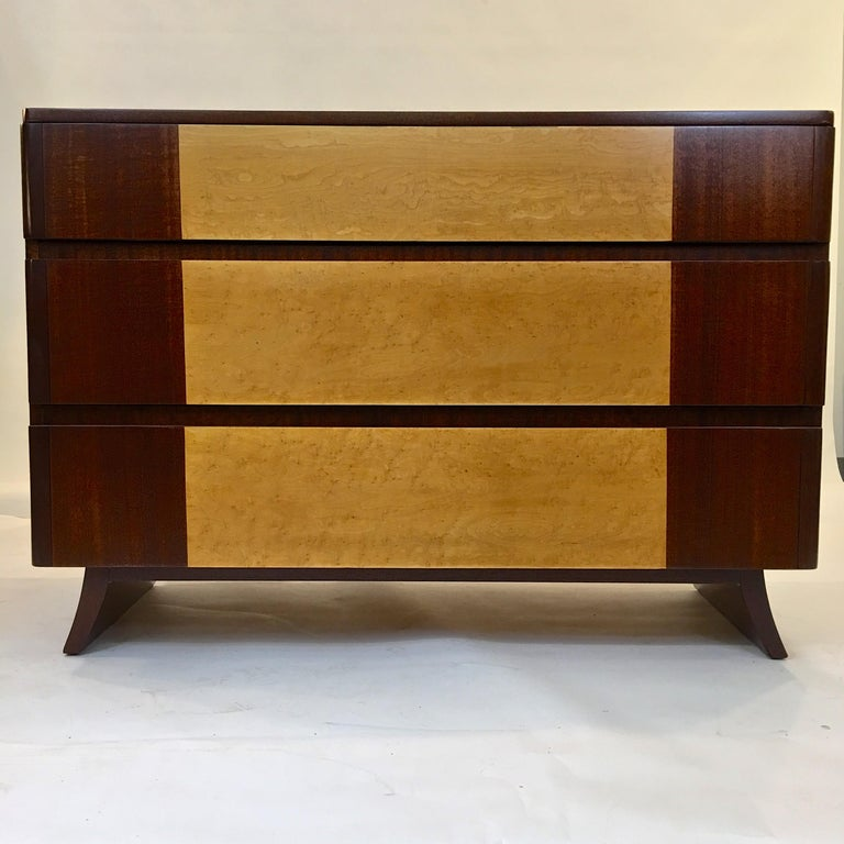 1940s American Art Deco chest of drawers with curved front edges on splayed legs by R-Way Furniture Co. in two-tone bookmatched mahogany and exotic burl elm inlay.