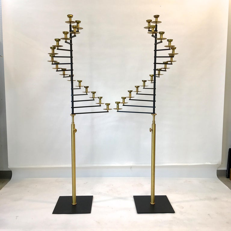 Pair of 6 foot 3 inch tall 15-light brass spiral fan candelabra, circa 1960, from a deconsecrated Rhode Island church.