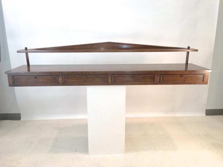 Gracious and at once both neoclassical and modern, this wall-mounted buffet console was designed by the late Ronnie Brahms and produced by the family owned furniture workshop of H. Sacks and Sons of Brookline, MA in the 1960s. Label inside first of