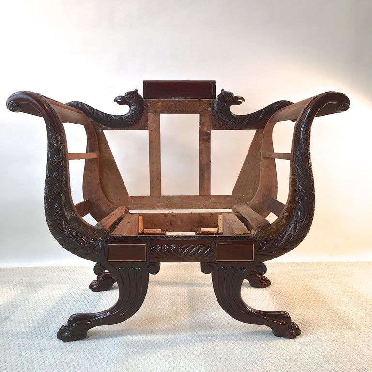 Mid-19th century American Empire chair, stripped, tightened and finish restored and polished, ready for your upholsterer's workbench.  It is most unusual to find seating of this period and style in this size. Sofas and settees were prevalent but I